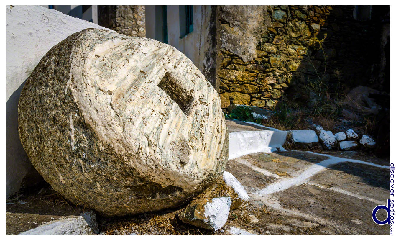Millstone in the alleys of Panagia